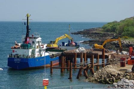 May 2016: Burhou 1 unloads boulders at the temporary pier next to the existing linkspan access road -- copyright Eric Schofield